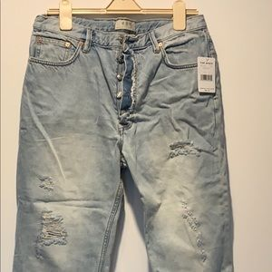 Never worn Free People Jeans. Distressed.